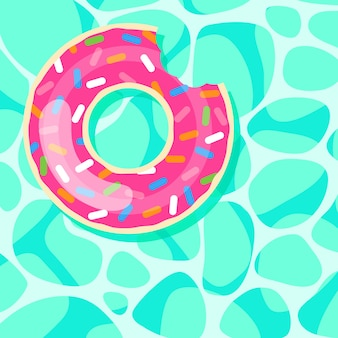 Pink donut swim ring floating on water  background