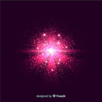 Pink explosion particle effect on black background