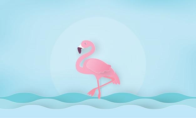 Розовый фламинго, стоящий в воде. каникулы