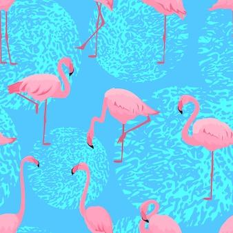 다른 포즈의 핑크 플라밍고. 원활한 여름 열 대 패턴입니다.