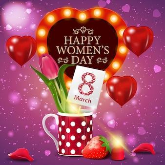 머그잔에 튤립과 여성의 날을위한 핑크 인사말 카드