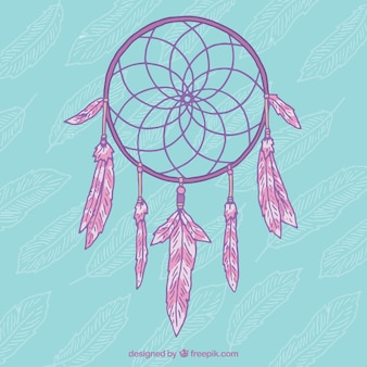 파란색 배경에 분홍색 손으로 그린 드림 캐쳐