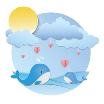 Pink heart hanging and two blue whale in the ocean