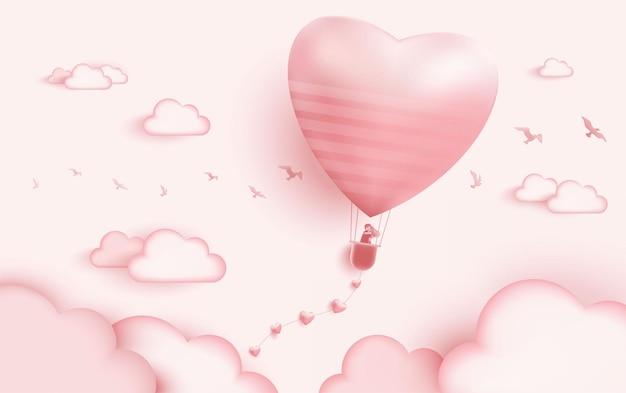 空にピンクのハート型の風船 Premiumベクター