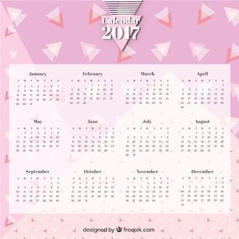 Розовый календарь memphis с треугольниками