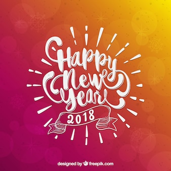 Pink and orange background with white lettering of new year