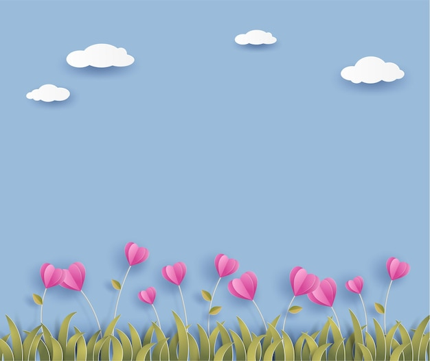 Pink origami flower in heart shape and grass on blue background with cloud.
