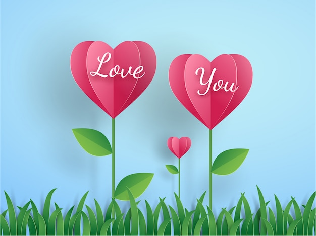 Pink origami flower in heart shape and grass on blue in valentine's card concept with text love you. vector illustration art design in paper cut style.