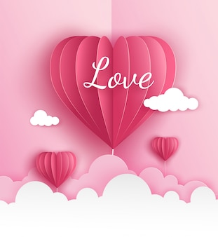 Pink origami paper of hot air balloon in heart shape flying on the sky over the cloud in valentine's day with label text love. vector illustration art design in paper cut style.