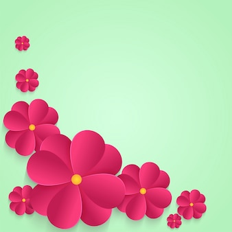 Pink paper flowers on abstract background.