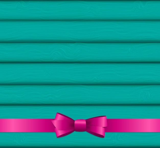 Pink ribbon and bow on wooden background for birthday christ