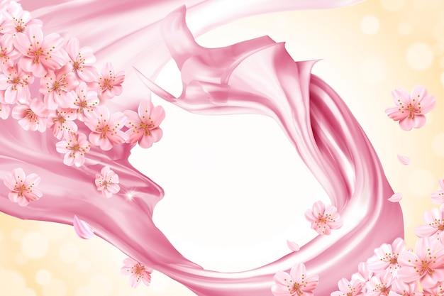 ピンクの滑らかなサテンと花の背景