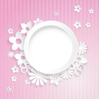 紙から切り取られたリングと花とピンクの縞模様の背景