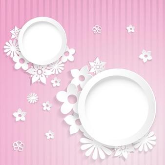 紙から切り取られた2つのリングと花とピンクの縞模様の背景