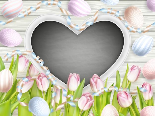 Pink tulips with blank blackboard.
