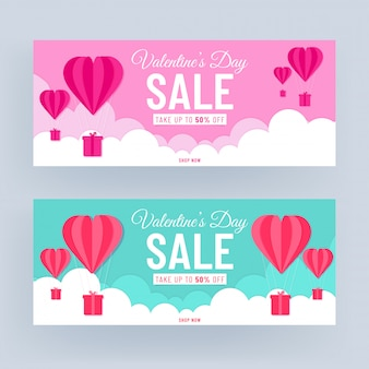 Pink and turquoise header or banner design with 50% discount offer and paper cut heart shaped hot air balloons on cloudy background for valentine's day sale.
