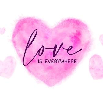 愛のテキストが付いているピンクの水彩ハート