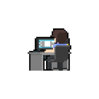 Pixel art man character working at computer desk.