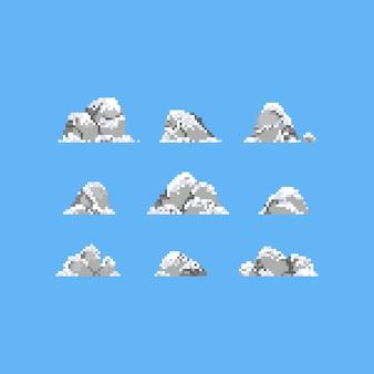 雪のアイコンと石のピクセルアートセット