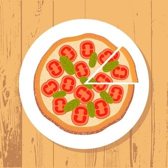 Пицца и кусочек пиццы на белой тарелке