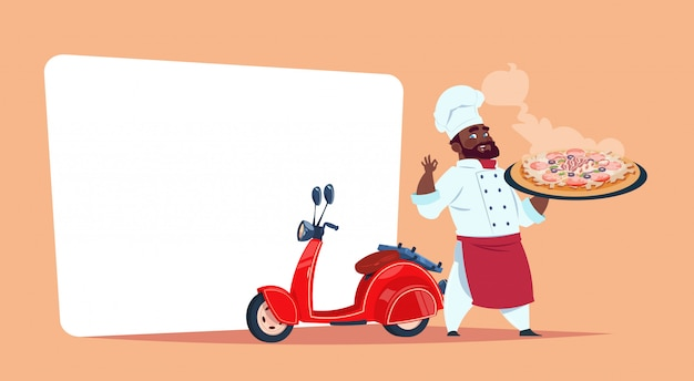 Pizza delivery concept african american chef cook hold box with hot dish standing at red motor bike template banner with copy space