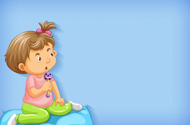 ベッドで遊ぶ少女と無地の背景
