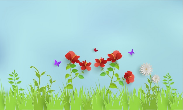 Plants and grass in spring. there are butterflies and beautiful sky