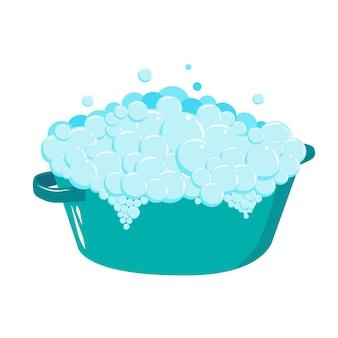 비누 거품이 있는 플라스틱 대야. 거품이 있는 비누 거품. 손으로 옷을 세탁.