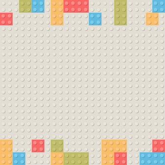 プラスチック製の建設ブロックの背景。子供のおもちゃビルディングブロックレンガ。