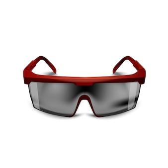白い背景の上のプラスチックの赤い安全黒メガネ。建設、医療、スポーツ用の作業用ゴーグル目保護具