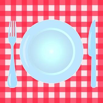 市松模様のテーブルクロスにプレート、フォーク、ナイフ