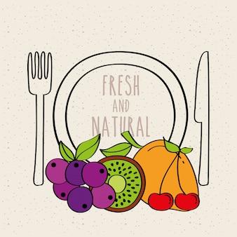 Plate fork knife kiwi grapes mango carambola fresh and natural