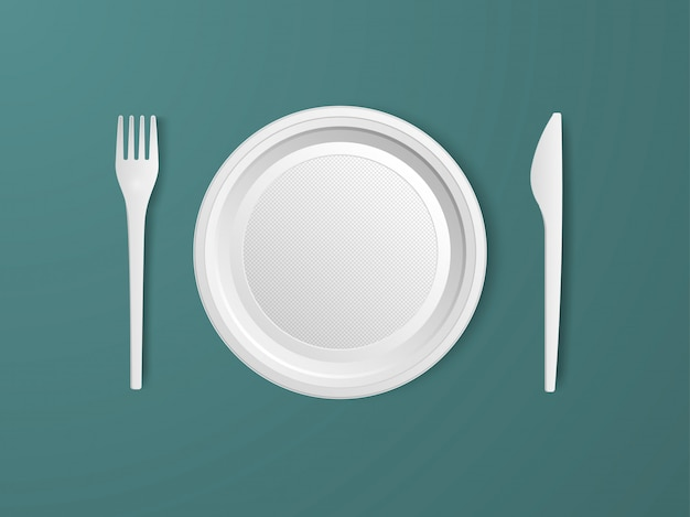 Plate, fork and knife. set of realistic plastic disposable tableware.
