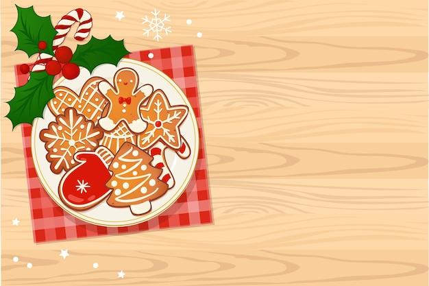 나무 테이블에 겨우살이와 사탕 지팡이가 있는 진저브레드 크리스마스 쿠키가 있는 접시. 새 해와 겨울 휴가 디자인에 대 한 상위 뷰 벡터 일러스트 레이 션.