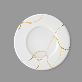 Plate with gold kintsugi on gray background. crack and broken effects.