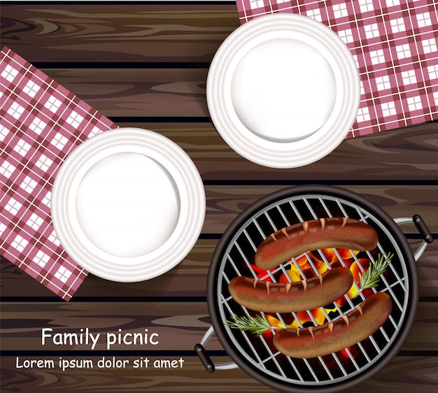 Plates on wooden table and sausages on the grill