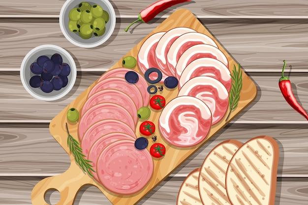 Блюдо из холодного мяса и копченостей на фоне стола