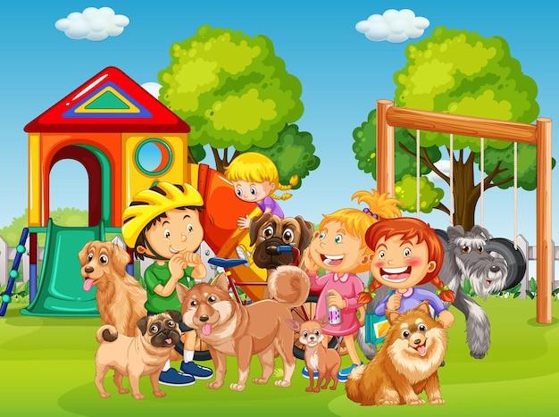 多くの子供たちとそのペットがいる遊び場の屋外シーン