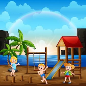 Playground scene on the beach with children