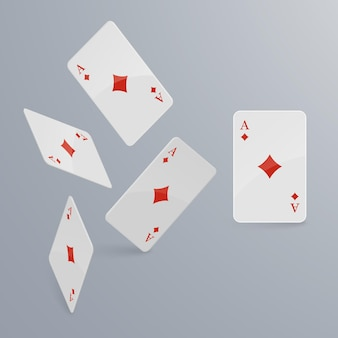 Playing cards falling on light background.