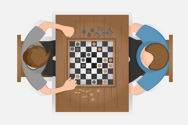 テーブルの上で真剣にチェスをする