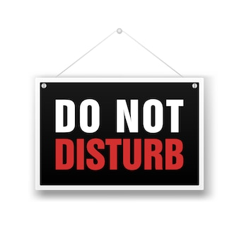 Please do not disturb, sign hanging on white