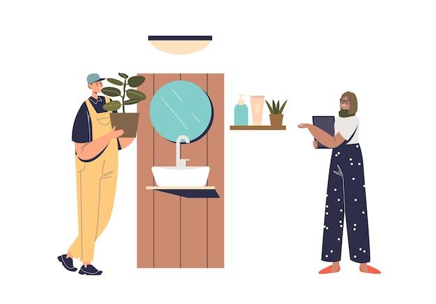 Plumber worker and designer working in modern bathroom on design