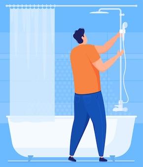 配管工事。配管工がバスルームのシャワーを修理します。図