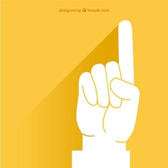 黄色の背景の上でポインティング指