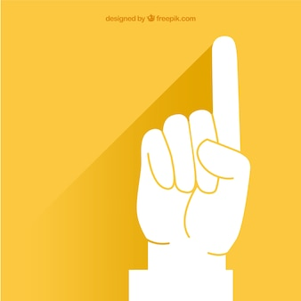 Pointing finger over yellow background