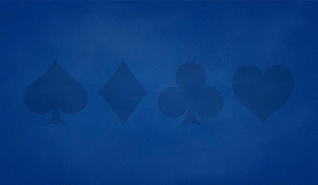 カードスーツと青い色のポーカーテーブルの背景。