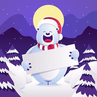 クリスマスバナーを保持しているシロクマ