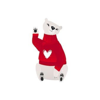 赤い冬のセーターの極白熊の赤ちゃん