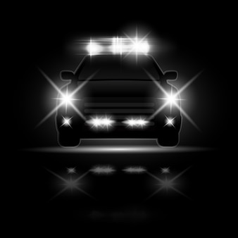 Police car with headlights flares and siren at the night road. special light beams